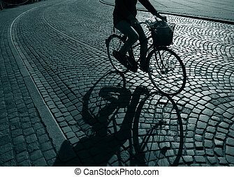 Lonely feamale cyclist