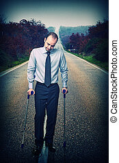 young businessman with crutch and long way background