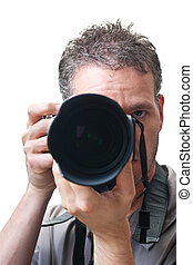 Looking into a telephoto lens, with a photographer behind, one eye open, isolated on white.