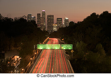 Los Angeles sunset highway traffic skyline
