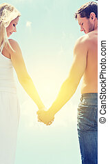 love couple man and woman holding hands on a sky