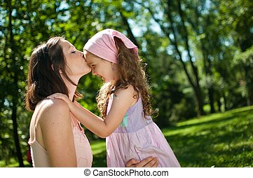 Love - mother kissing her child