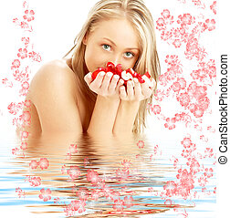 blond with red and white rose petals and flowers in water