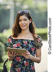Lovely brunette with digital tablet