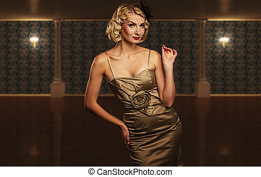 Lovely retro woman over blurred background.