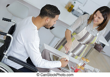lovely wife cooking or her disabled husband