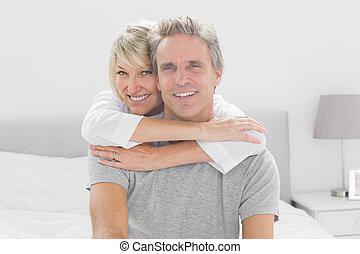 Loving couple smiling at camera