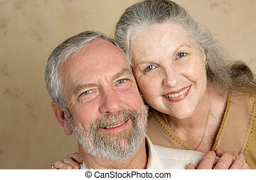 Portrait of a beautiful gray haired middle aged couple in love.