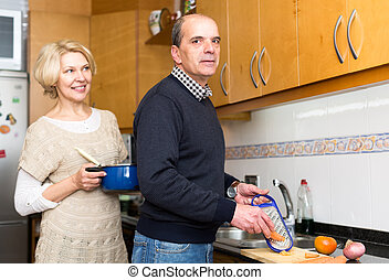 Loving senior husband helping wife