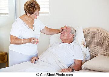 loving senior wife comforting ill husband