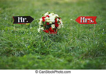 luxury bouquet of red and white flowers top view with red bow on wedding day holiday. Mr and Mrs