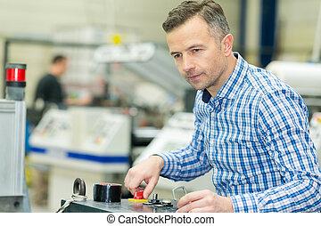 machine operator turning knob