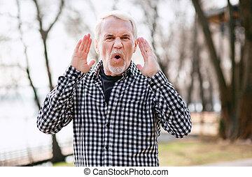 Mad senior man screaming