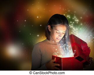 Magic Christmas present with surprised girl