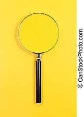 Magnifier on yellow background.