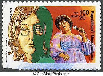 MALAGASY REPUBLIC - CIRCA 1994: A stamp printed in Malagasy Republic (Madagascar) shows John Lennon (1940-1980), Ella Fitzgerald (1917-1996), circa 1994