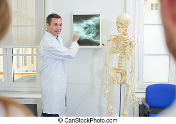 male doctor during a lecture - skeleton