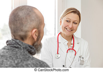 male patient is consulting a female doctor