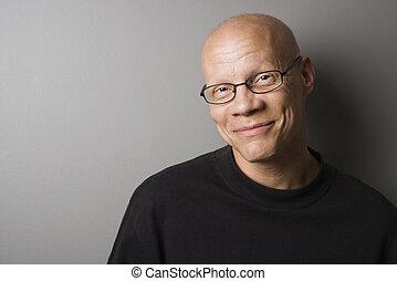 Portrait of mid-adult Caucasian male.