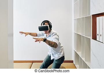 Man amazed with virtual reality
