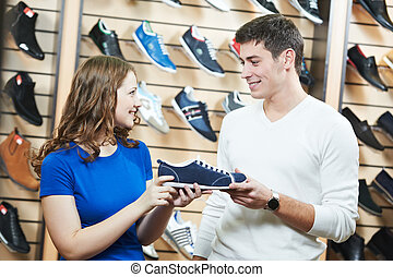 man and assistant at shoe shopping