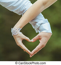 lovers couple making a heart with hands
