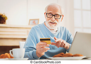 Man checking his debit card number while conducting transaction