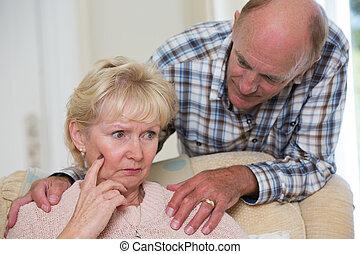 Man Comforting Senior Woman With Depression