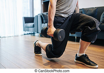 Man doing lunges with dumbbells