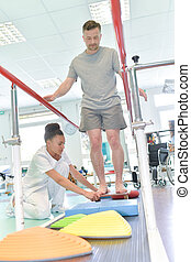 man doing running training with physiotherapist in nursing home
