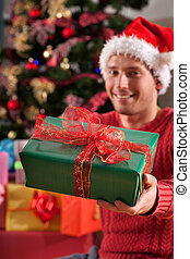 Man in santa's disguise with a present