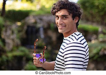 man in shirt posing in nature