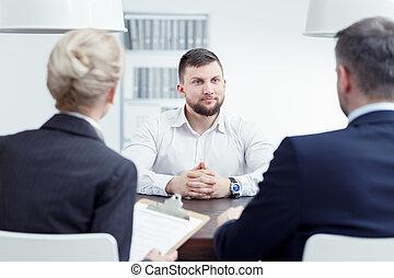Man listening to examination board