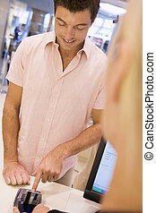 Man making purchase with credit card
