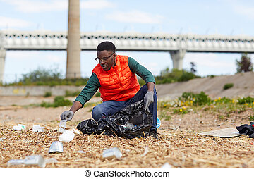 Man picking up the garbage