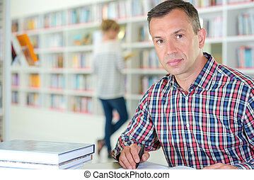 man posing in the library