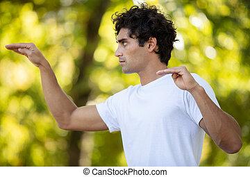 man practice meditation yoga in public park
