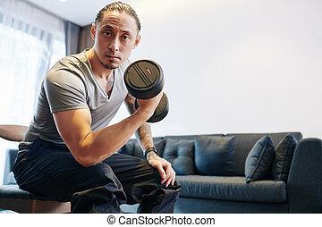 Man pumping biceps