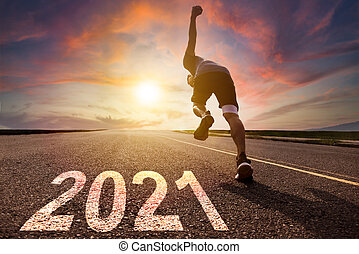 man running and sprinting on road with 2021 new year concept