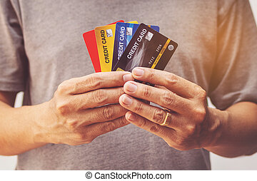 man showing bunch of credit cards