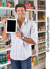 Man Showing Digital Tablet In Supermarket
