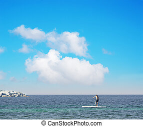 man surfing on sup