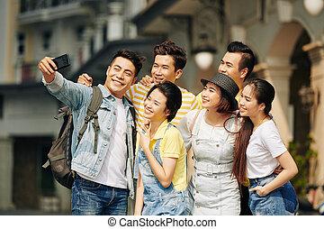 Man taking selfie with friends