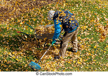 Man trying to clean up the lawn