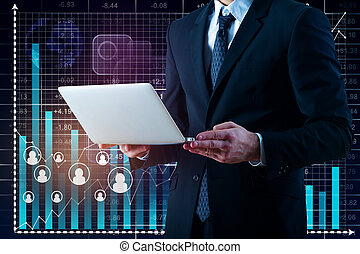 Man using laptop with business charts