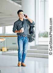 Man walking in airport terminal