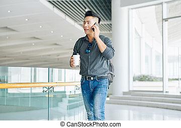 Man walking in office building