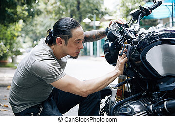 Man Wiping Bike With Soft Cloth