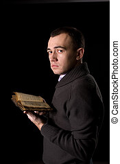 man with antique book