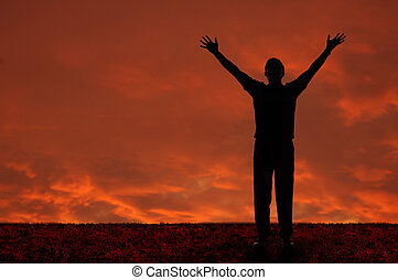 Man with arms extended toward heaven